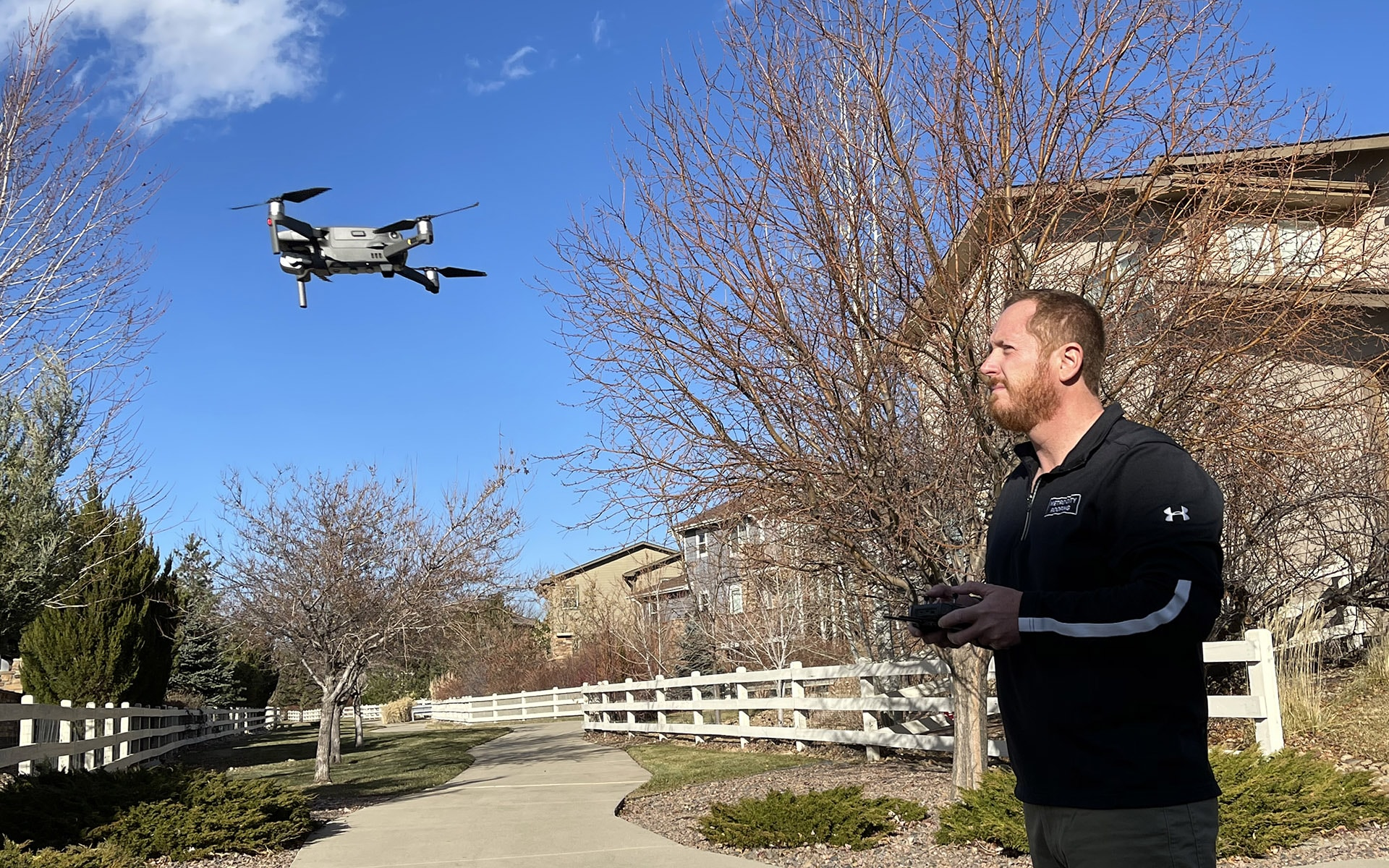 Metro City Roofing salesperson flying a drone to inspect a roof in Broomfield, Colorado
