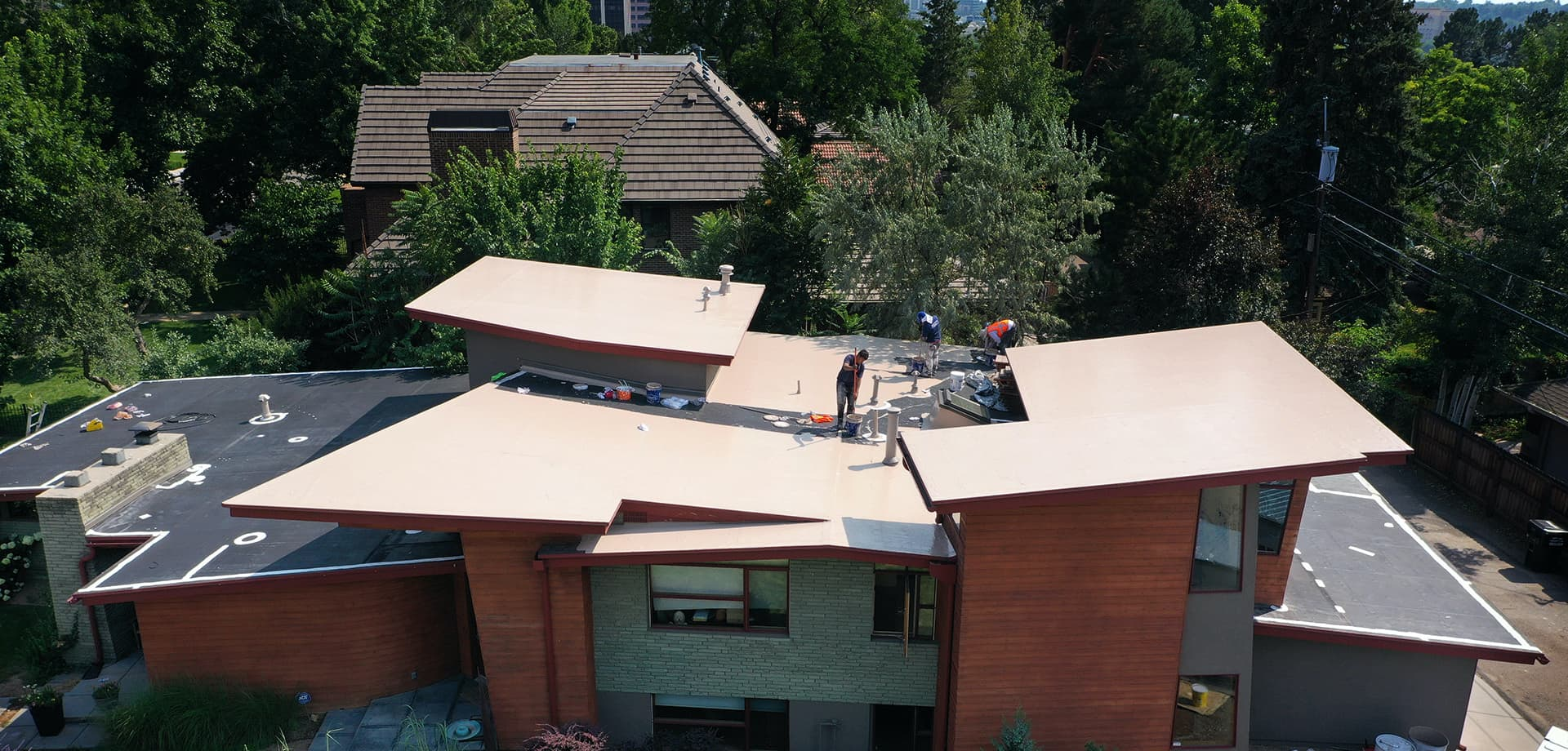 Tan silicone coating on a modern Denver, CO home